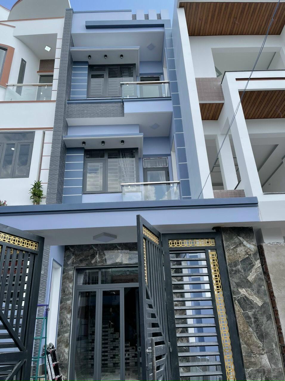 Bán nhà Dĩ An trệt hai lầu mới hoàn thiện gần chợ Dĩ An 1 sổ hồng riêng phường Tân Đông Hiệp, TP Dĩ An